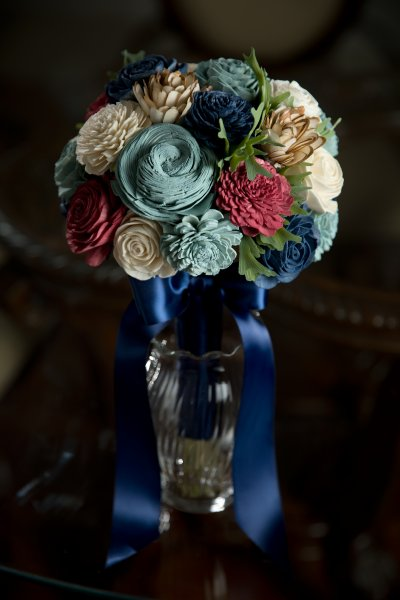 wood flower bridal bouquet with blue and red
